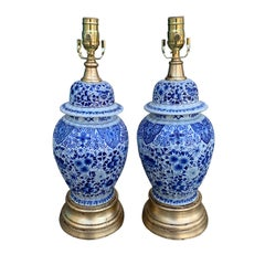 Pair of 19th Century Dutch Delft Blue and White Lamps, Gilded Bases
