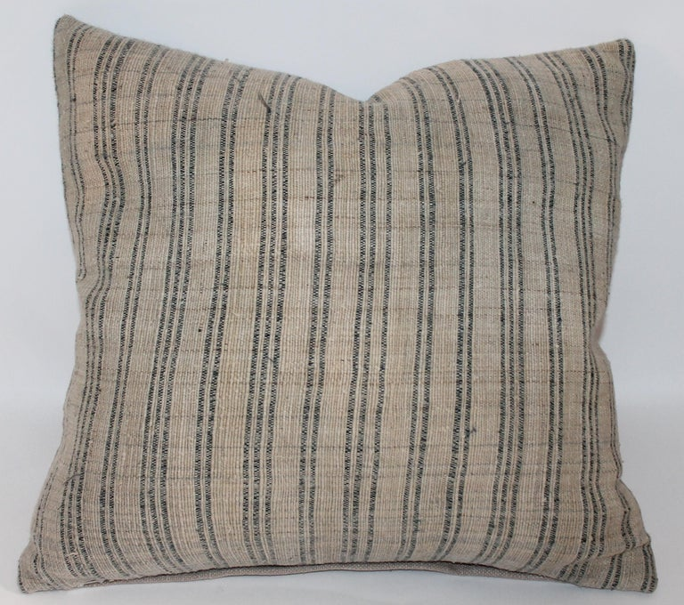 These early homespun striped linen pillows have natural tan cotton linen backings. There are two pairs in stock.