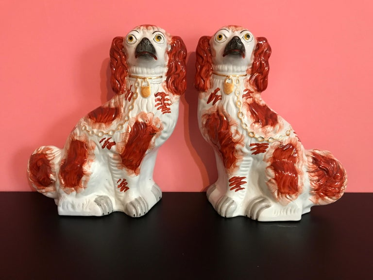 Pair of #1 Staffordshire English red seated Spaniel dogs, circa 1865, exceptional examples.