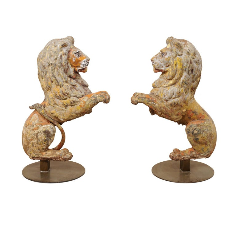 Pair of 19th Century English Cast-Iron Lion Statues For Sale