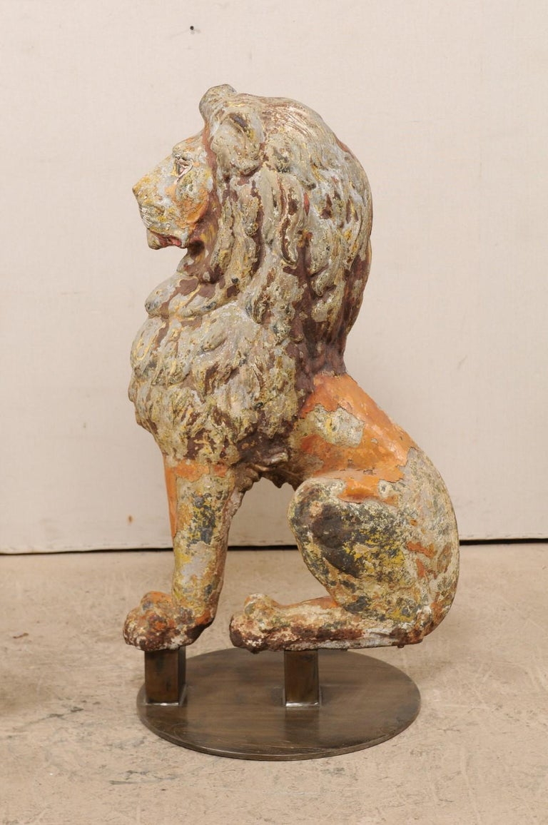Metal Pair of 19th Century English Cast Iron Sitting Lion Statues For Sale