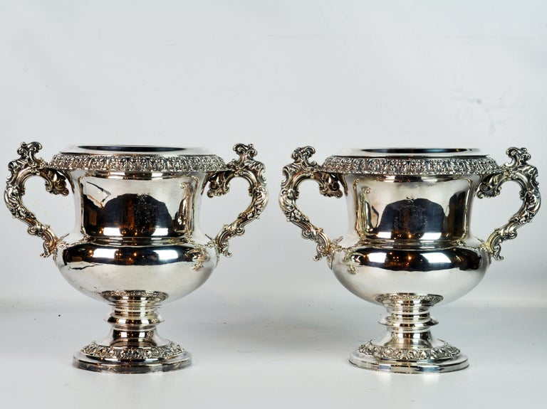 This is a wonderful and well kept pair of English Sheffield wine coolers dating to the mid-19th century. The craftsmanship is stunning, especially the Rococo style heavily ornate handles. Each cooler has an insert under a detachable top ring, see