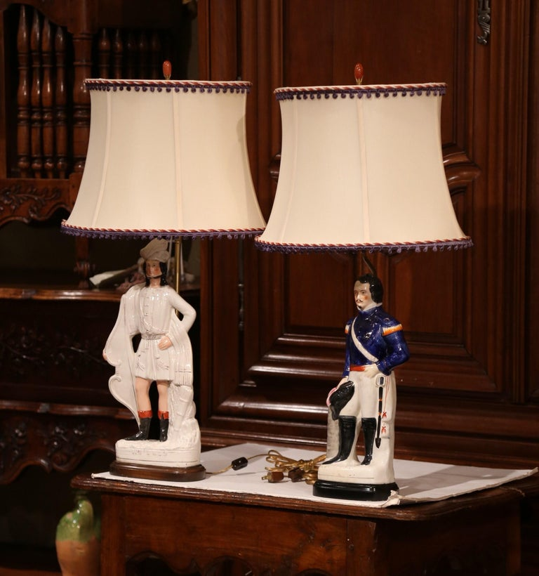 Place these tall decorative Majolica lamps in a living room or on bedside tables; created in England, circa 1890, the porcelain Staffordshire figurines depict two important figures of France and Switzerland; Louis Napoleon and Guillaume Tell. Both