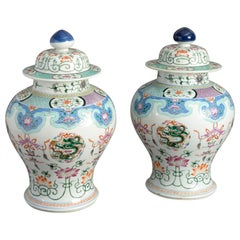 Pair of 19th Century Famille Rose Porcelain Vases and Covers