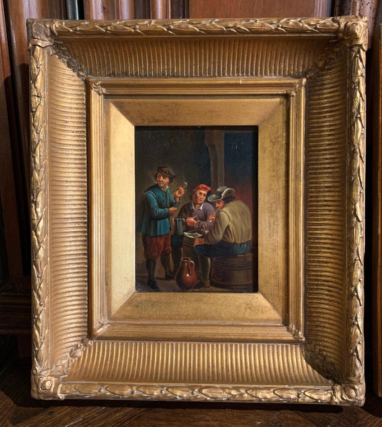 Decorate an office or a study with this elegant pair of antique paintings on copper. Created in Holland circa 1860 and set in their original carved gilt frames, each painting depicts a tavern scene with peasants in traditional clothing in the matter