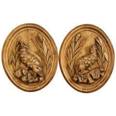 Pair of 19th Century French Black Forest Carved Oval Wall Hanging Bird Plaques