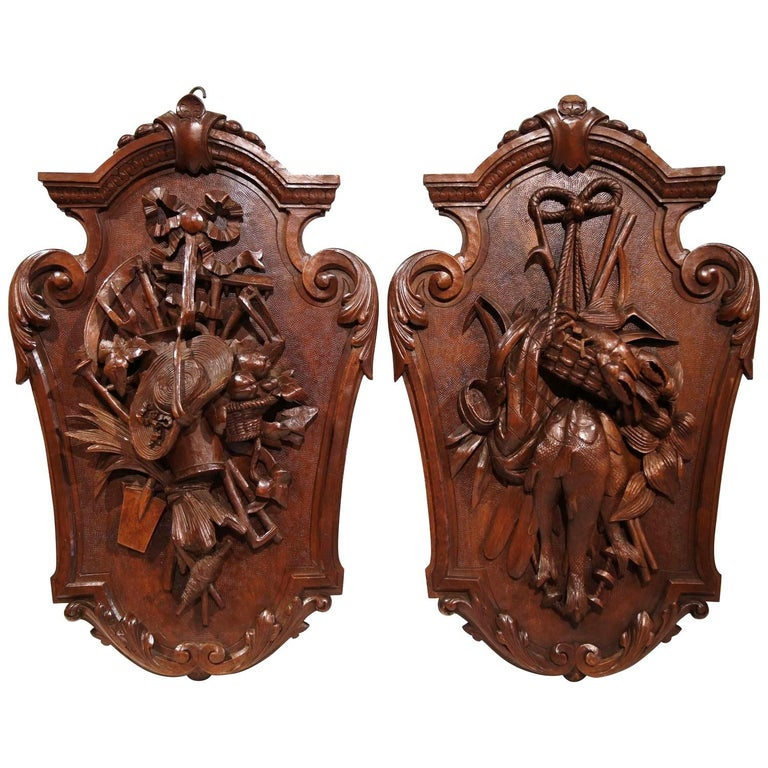 Pair of 19th Century French Black Walnut Carved Walnut Wall Trophy Sculptures For Sale