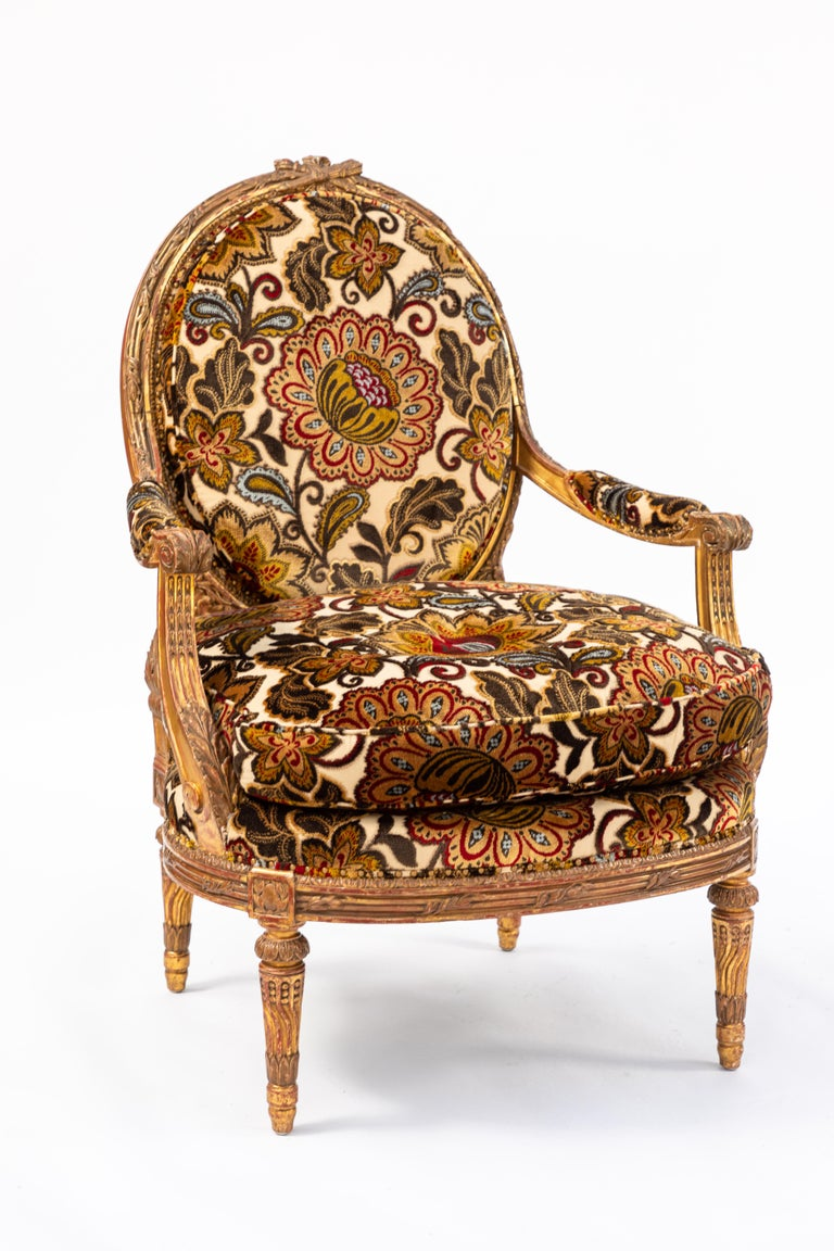 Pair of fine 19th century French carved giltwood armchairs with newly upholstered cut velvet floral fabric.