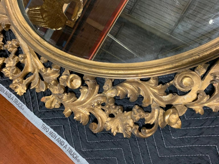 Wood Pair of 19th Century English Carved Giltwood Oval Mirrors For Sale