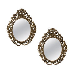 Pair of 19th Century English Carved Giltwood Oval Mirrors