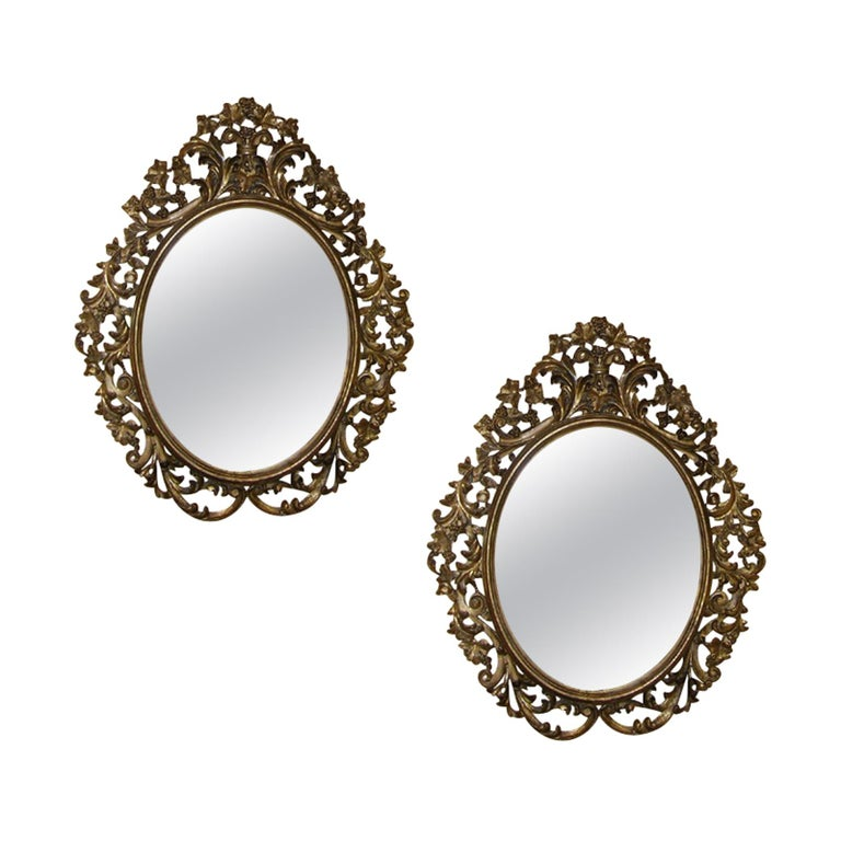 Pair of 19th Century English Carved Giltwood Oval Mirrors For Sale