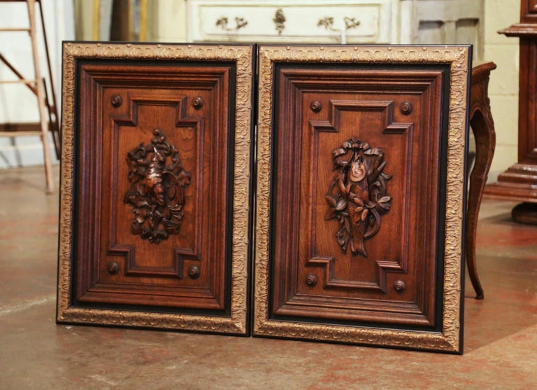Decorate a man's office with this pair of elegant antique panels. Crafted in France circa 1870, and made of oak, the sculpted elements are decorated with exquisite carvings in high relief; one-door features a central medallion with a bird, foliage