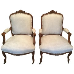Pair of 19th Century French Carved Walnut Chairs with New Upholstery
