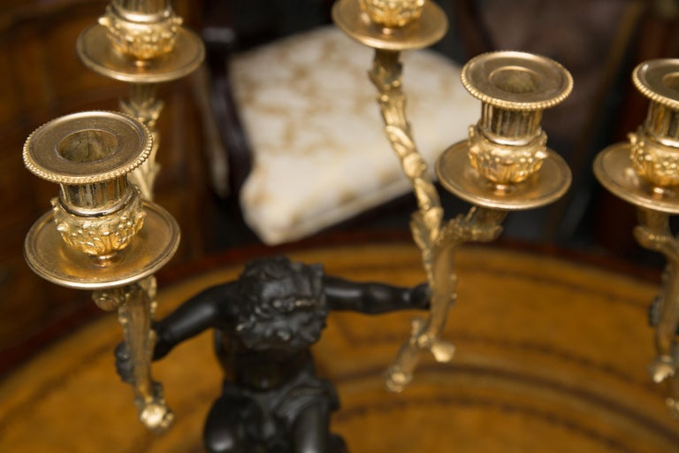 Pair of 19th Century French Gilt and Patinated Bronze Cherubs as Candelabra In Good Condition For Sale In WEST PALM BEACH, FL