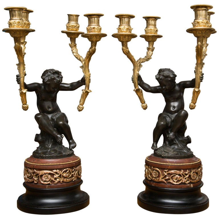 Pair of 19th Century French Gilt and Patinated Bronze Cherubs as Candelabra For Sale