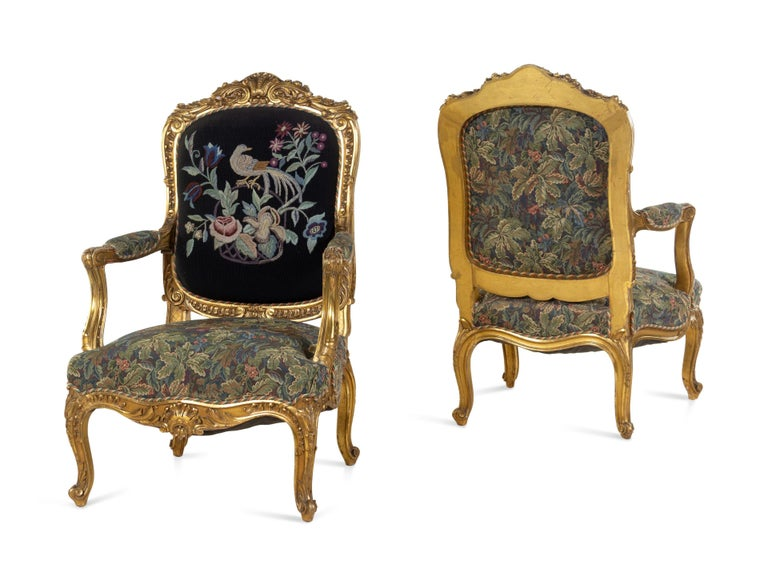 Beautiful large pair of well carved 19th century French Louis XV giltwood fauteuils. Covered in a tapestry.