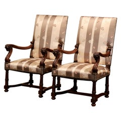 Pair of 19th Century French Louis XIII Carved Walnut Armchairs with Ram Decor