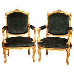 Pair of 19th Century French Louis XV Carved Giltwood Bergères with Green Velvet