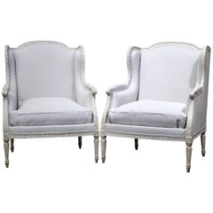 Pair of 19th Century French Louis XVI Carved and Blue Grey Painted Armchairs