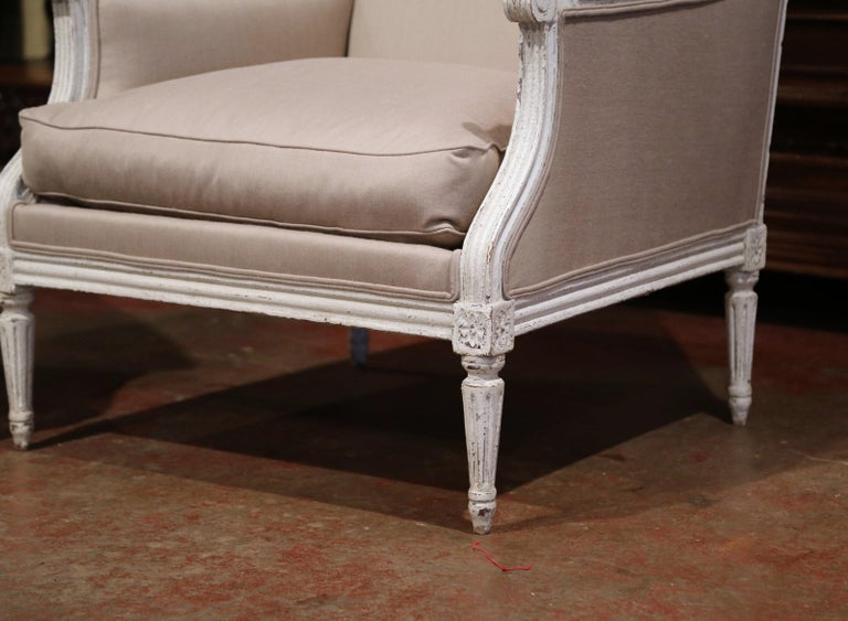 Fabric Pair of 19th Century French Louis XVI Carved Painted Upholstered Armchairs For Sale