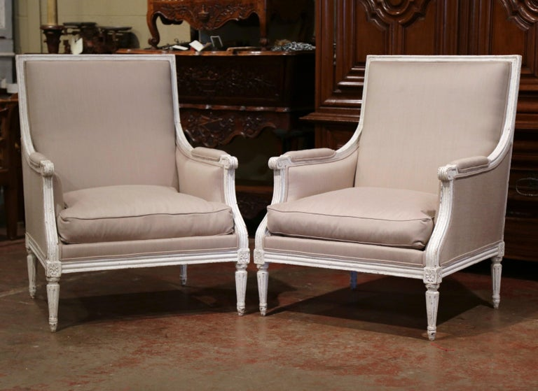 Pair of 19th Century French Louis XVI Carved Painted Upholstered Armchairs For Sale 1