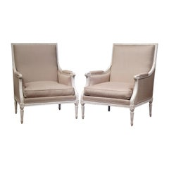 Pair of 19th Century French Louis XVI Carved Painted Upholstered Armchairs