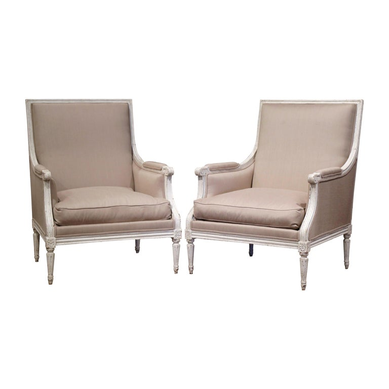 Pair of 19th Century French Louis XVI Carved Painted Upholstered Armchairs For Sale
