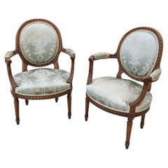 Pair of 19th Century French Louis XVI Fruitwood Armchairs