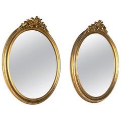 Pair of 19th Century French Louis XVI Oval Gilded Mirrors
