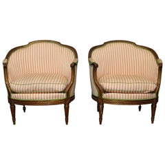 Pair of 19th Century French Louis XVI Style Armchairs with a Gold Leaf Finish