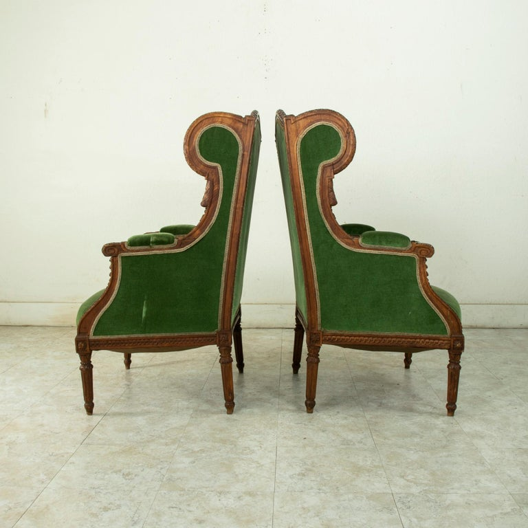 Hand-Carved Pair of 19th Century French Louis XVI Style Walnut Wingback Armchairs, Bergeres