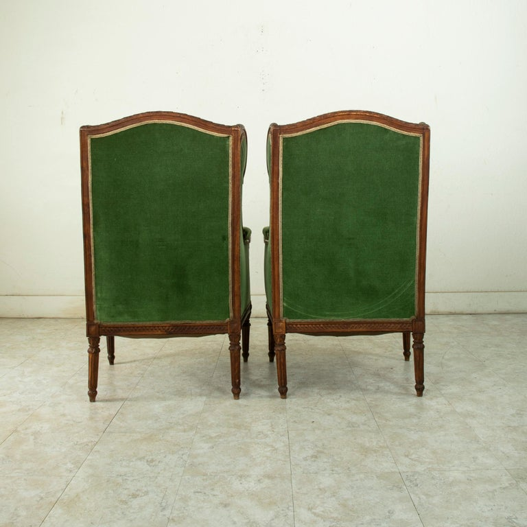Pair of 19th Century French Louis XVI Style Walnut Wingback Armchairs, Bergeres In Good Condition In Fayetteville, AR