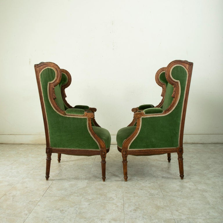Mohair Pair of 19th Century French Louis XVI Style Walnut Wingback Armchairs, Bergeres
