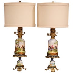 Pair of 19th Century French Painted Porcelain & Brass Oil Lamps with Hunt Scenes