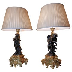 Pair of 19th Century French Patinated Bronze and Gilt Bronze Figural Lamps