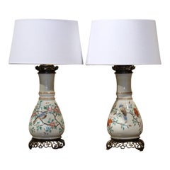 Pair of 19th Century French Porcelain and Brass Oil Table Lamps with Bird Decor