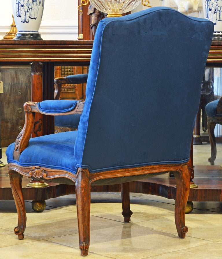 Fabric Pair of 19th Century French Provincial Carved Walnut Open Armchairs For Sale