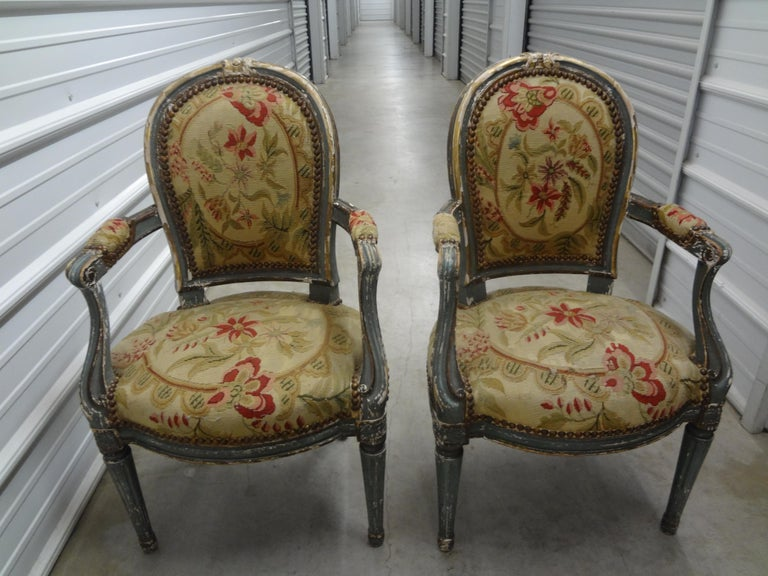 Stunning pair of 19th century French Régence style children's chairs or child's chairs. These antique French Regence style children's chairs have a beautiful distressed painted finish and are upholstered in 19th century needlepoint tapestry with