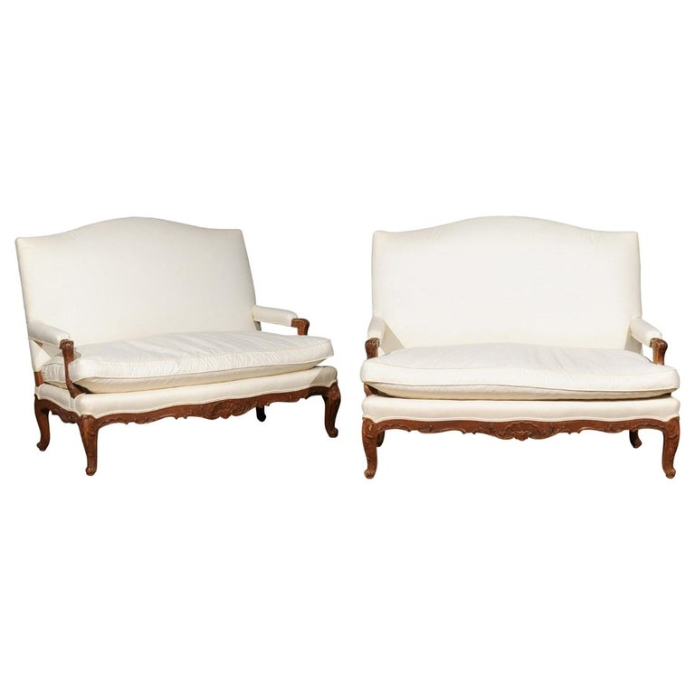 Pair of 19th Century French Régence Style Upholstered Canapés with Cabriole Legs For Sale