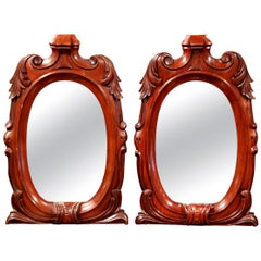 Pair of 19th Century French Regency Carved Mahogany Mirrors with Foliage Decor