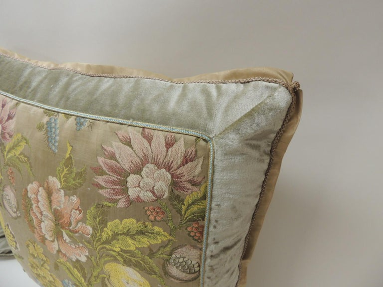 Pair of 19th century French brocade floral decorative pillows Pair of yellow and green floral square antique textile decorative pillows. Colorful French woven silk brocade pillows, framed with silk velvet and embellished with a small silk blue and