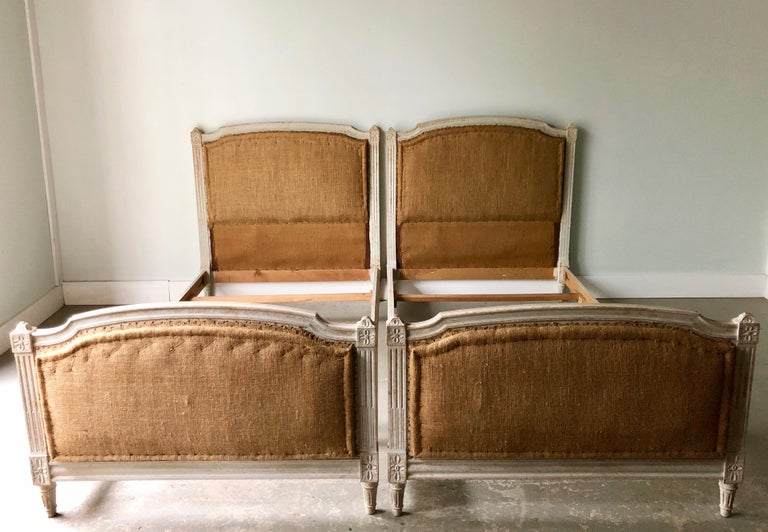 A pair of late 19th century French single beds with beautiful details, ready for your own selected upholstery. Beds are in parts of: 2 headboards 2 footboards 4 rails 4 mattress supports Inside measurements: W 76