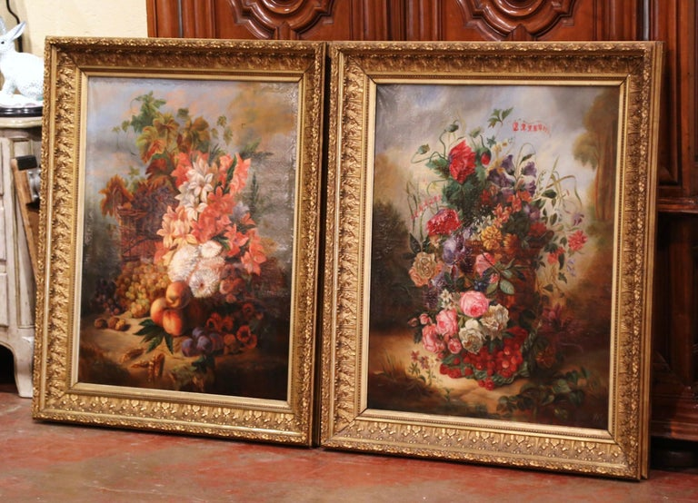 Invite color into your home with this large pair of antique, floral paintings. The artworks were crafted in France circa 1870, and are set in carved gilt frames. Each canvas features an elegant bouquet of flowers. The paintings are in excellent