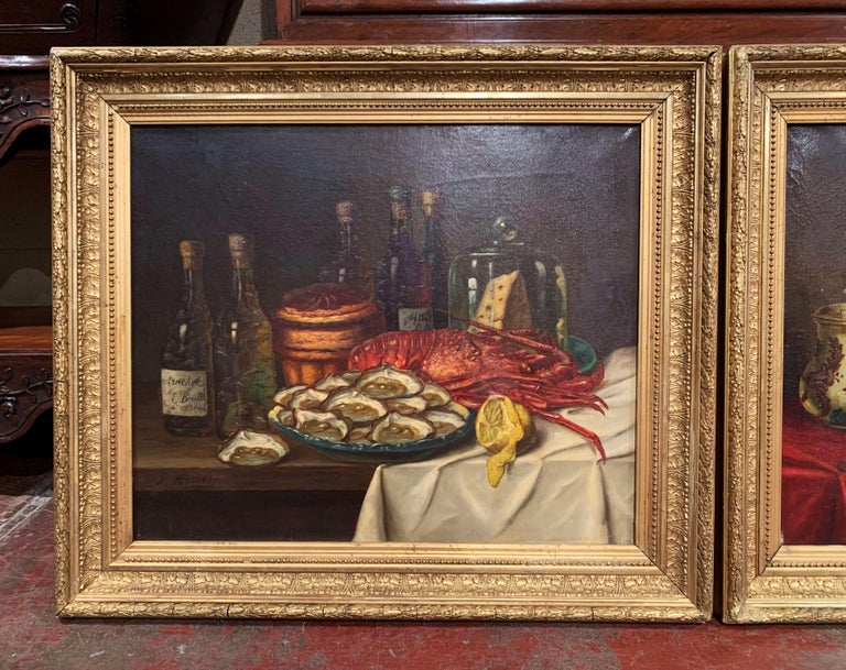 Invite vibrant color into your home with this traditional pair of antique still life paintings. The paintings were crafted in France circa 1880 and are set in ornate, carved gilt frames. Each canvas depicts