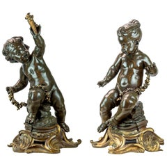 Monumental Pair of 19th Century Gilt and Patinated Bronze Sculptures of Putti