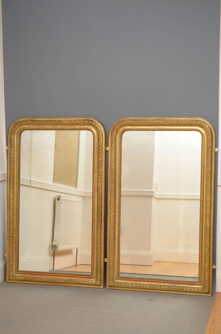 Sn4758 pair of French gilded wall mirrors, each having original glass with some foxing in moulded and carved giltwood frame. This pair of mirrors retain original glass, gilt and backboards all in fantastic home ready condition, circa