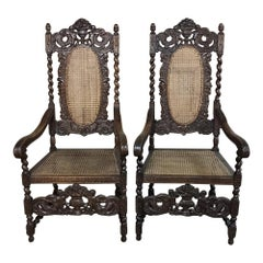 Pair of 19th Century Grand Renaissance Hand Carved Oak and Caned Armchairs