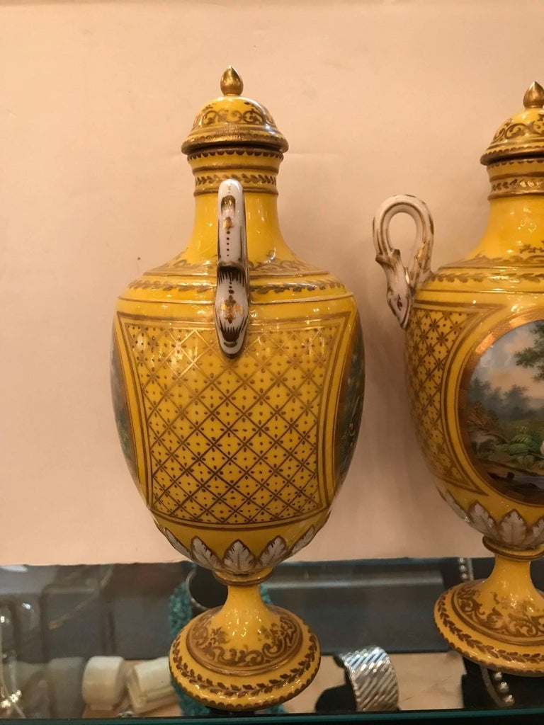 Pair of 19th Century Hand Painted French Porcelain Lidded Urns In Good Condition For Sale In Lambertville, NJ