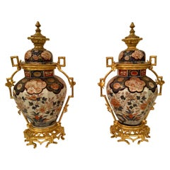Pair of 19th Century Imari Porcelain and Ormolu Mounted Urns, circa 1840-1860
