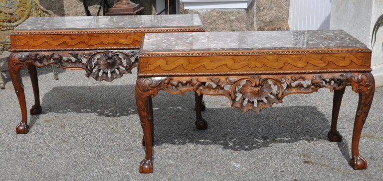 Pair of Irish walnut marble top console tables in the Georgian style  Fine walnut Chippendale George II ball and claw foot console tables. Frieze with running dog motif, exquisite Rococo carving. Four cabriole legs. Original finish. Fossilized